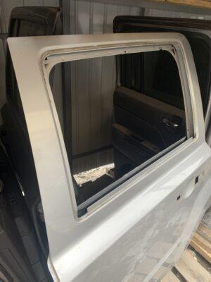 Дверь задняя левая Jeep Patriot 2010-17 серебро USA